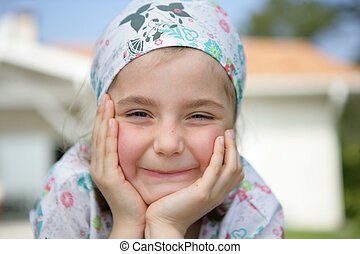 Little girl wearing a bandanna