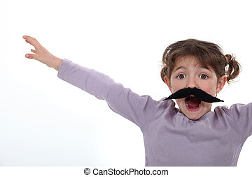 Little girl wearing a fake moustache