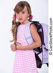 Little girl wearing backpack