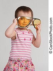 Little girl wearing huge glasses