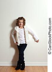 little girl wearing jeans