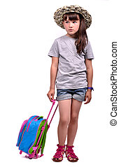 Little girl wearing palm hat with a travel bag
