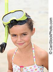 Little girl wearing snorkel