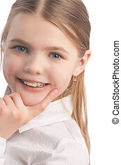 little girl wearing teeth braces - young cute caucasian...