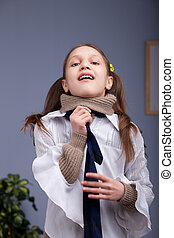 little girl wearing up a necktie like a man