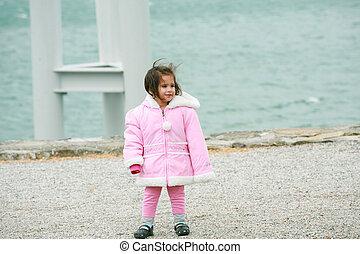Little girl wearing winter outwear