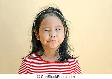 Little girl winking eye