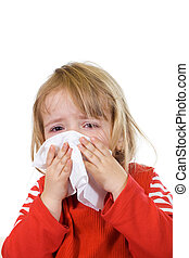 Little girl with the flu blowing her nose - isolated