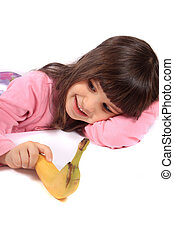 Little girl with a banana