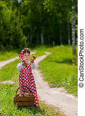 Little girl with a basket of mushrooms.