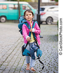 Little girl with a big backpack