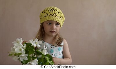 Little girl with a blooming twig