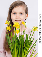 girl with a bouquet of yellow daffodils