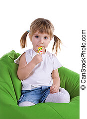 Little girl with a bright lollipop