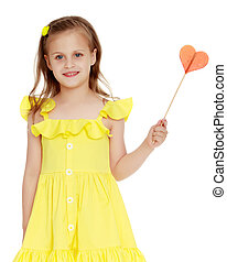 Little girl with a candy on a stick