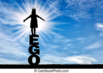 Little girl with a crown on her head standing on the word of the ego