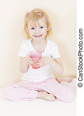 little girl with a cup of water