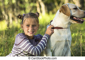 Little girl with a dog