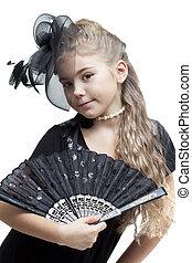 Little girl with a fan