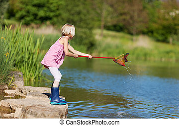 Little girl with a fishing net