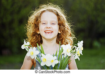 Little girl with a flower in her hand. Mothers day concept.