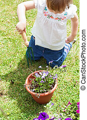 Little girl with a flowerpot