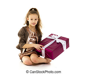 Little girl with a gift. Isolated on white background