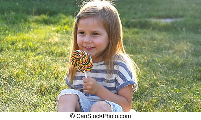 little girl with a lollipop