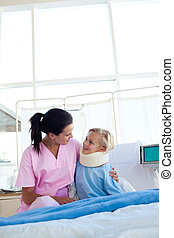 Little girl with a neck brace