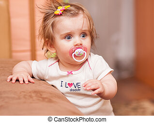 little girl with a pacifier