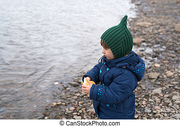 Little girl with a piece of bread