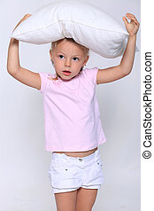 little girl with a pillow on her head