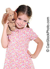 Little girl with a soft toy on the white background