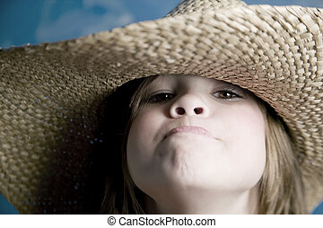 Little girl with a straw hat - Little girl wearing a straw...