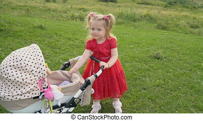 little girl with a stroller