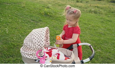 little girl with a stroller - a little girl with a baby...