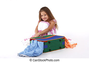 little girl with a suitcase