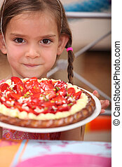 Little girl with a tart