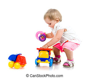 little girl with a toy car