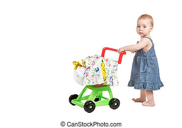 Little girl with a trolley - Little girl in denim dress with...
