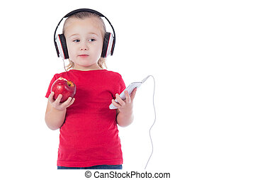 little girl with an apple and a phone headphones