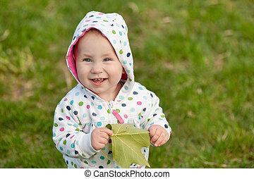 Little girl with an autumn leaf