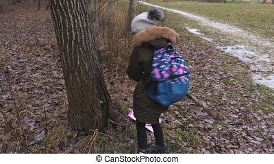 Little girl with backpack after school doing nonsense