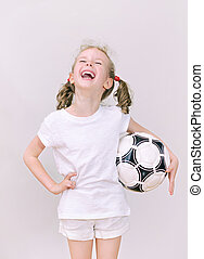 Little girl with ball having fun.
