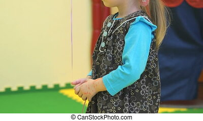 Little girl with balloon in kindergarten