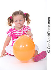 Little girl with balloon isolated on white background