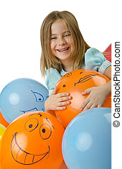 Little girl with balloons on white
