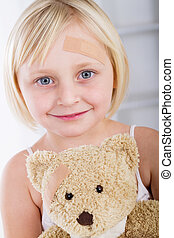 Little girl with band-aid on