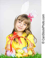 Little girl with basket of Easter eggs