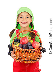 Little girl with basket of fruits, isolated on white